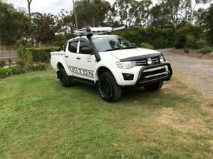 2014 Mitsubishi Triton MN MY15 GLX Double Cab White 5 Speed Manual Utility Capalaba Brisbane South East Preview