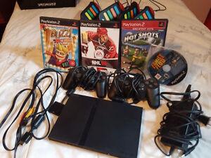 PS2 Slim + 2 manettes + 7 jeux