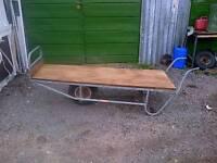 Old style nursery wheelbarrow for sale.
