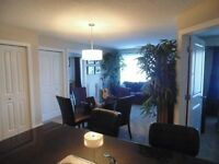 Cozy condo Cochrane 2 Bedrooms+big den,2 Bathrooms, und.parking.