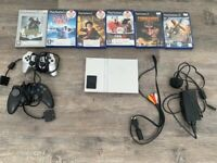 PS2 (PlayStation 2) with 2 controllers, memory card and game bundle