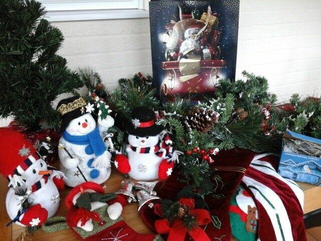 christmas decorations snowmen stocking long garland lights small christmas tree