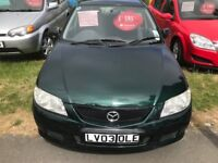 MAXDA 323 VERY GOOD CONDITION 59000 MILES ONE YEAR MOT DRIVES PERFECT QUITE AND SMOOTH NO FAULTS