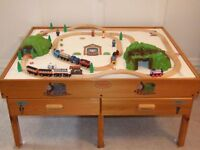 For Sale a Train Table And Wooden Train Set.