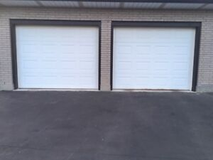 9'W x 7'H GARAGE DOORS WITH OPENERS & TRACKING SYSTEM
