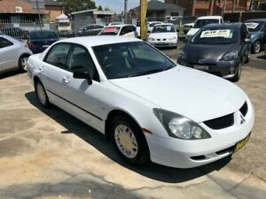 2004 Mitsubishi Magna TL ES Sedan 4dr Spts Auto 4sp 3.5i White Sports Automatic Sedan Bass Hill Bankstown Area Preview