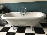 Free standing bath, on chrome legs, sink and loo, traditional style.