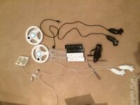 Awesome Nintendo Wii Bundle, Console, 4 controllers, a mike, 4 nunchucks, 2 wheels, 16 games