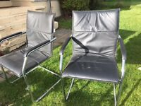 2 chrome frame/black faux leather chairs