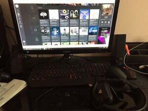 Gaming computer with headset, keyboard, mouse and Monitor
