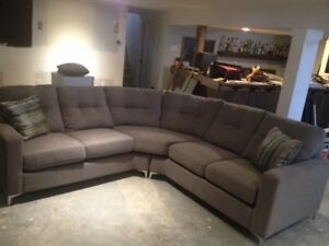 Brand new sectional with throw pillows.
