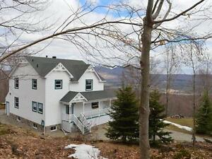 Beautiful 4 bdrm home w/7 acres, amazing views, and