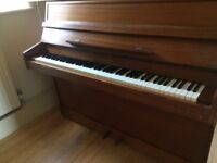 Modern upright piano, well maintained. It has 85 keys and 2 pedals.