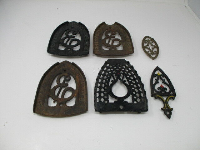 Lot of 6  Stove And Range Cast Iron Trivets  3 Enterprise Brand  Good Condition