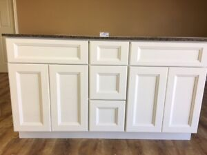 Factory Prices on Vanities, Kitchen Cabinets, Stone & More
