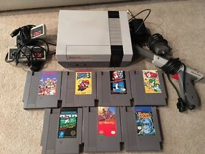Nintendo NES system w/ all hook ups, 2 controllers & 7 games +