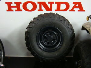 Honda TRX420PGC Maxxis M978 and M977 Tires on Rims