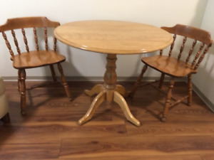 "Free small round oak table 36"" diameter with 2 drop leaves"