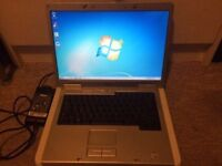 Dell Inspiron laptop , complete with the charger