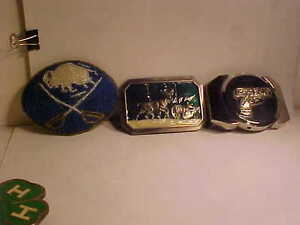 6 belt buckles  $40.00 takes them all or BEST ACCEPTABLE OFFER