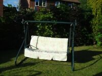Double width swinging garden chair with cushion (B & Q type).