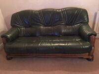 Green three seater leather sofa with oak base