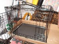 Small metal dog cage ,surplus to requirements.