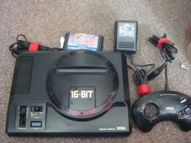 sega mega drive with a 32 game cartridge for sale or swap