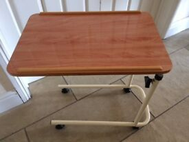 Table to go over a bed or chair, laminated teak with wheels, adjustable height