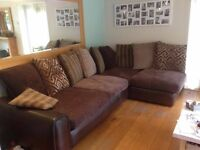 Large Leather / Fabric corner sofa with matching footstool (Furniture Village)