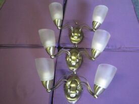 Three double brass wall light fittings