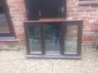 Garage window for sale with dark brown wooden frames 134cm x 90 cm including frame