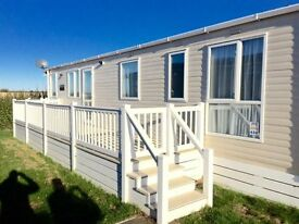 Front row cheap luxury static caravan for sale with beach access, swimming pool, dog friendly