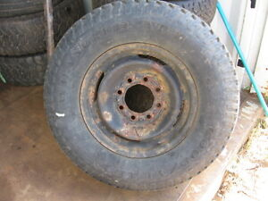 One used tire & rim 8 stud Chevy or GMC 3/4 ton reference AAA12