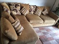 Corner sofa with matching footrest