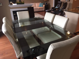 Glass & Expresso Dining Room Table with 6 Ivory Chairs.