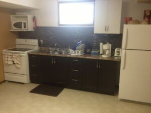 fully furnished 1400 sq ft basement suite. free utilities!