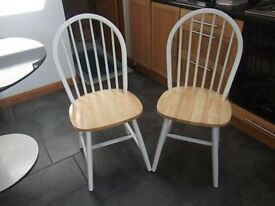 2 As New Kitchen chairs, matching in buttermilk paint and natural wood seats.