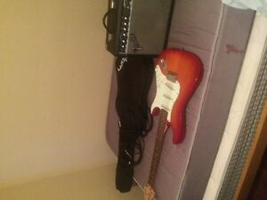 Fender Stratocaster for sale with amp and cords + case