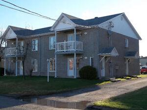 Bloc appartement 4 logements 495 000$ négociable