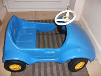 Blue pedal car