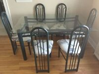 Dinner set ,Glass table with 6 chairs perfect condition