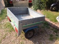 Trailer with spare wheel and cover.