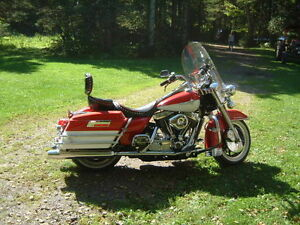Harley FLH touring...pratically new..with bags...lots of chrome