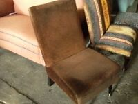 Lovely little low bedroom chair in a brown fabric.