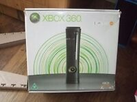 X box 360 Live complete with 6 games, headset and controller. In original box
