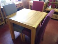 This New Compact Oak Square flip top extending dining table doubles in size from 3 to 6 seat £289
