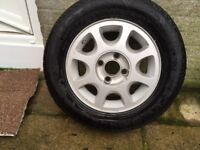 peugeot or ford 4 x 100 alloy rim +new 195 x 65 14 tyre never used