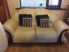 2 x 2 seater cream leather sofas in good condition