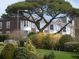 Fabulous 2 bed top floor Flat with wonderful sea views and garage.